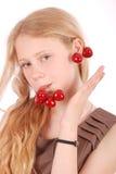 Girl hold in lips fresh cherries Stock Image