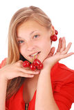 Girl hold in lips fresh cherries Stock Photography
