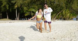Girl Hold Man Hand, Running On Beach, Happy Smiling Tourists Couple On Sea Vacation. Slow Motion 60 stock video footage