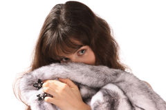 A girl hold a mink fur coat. Portrait of  beautiful young woman is in a mink fur coat. Isolated Royalty Free Stock Image