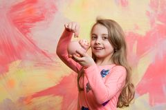 Girl hold moneybox or piggy bank for savings. Crisis and loan. Sale and black friday shopping. Bankruptcy and handout. Child with happy face save money for Royalty Free Stock Photos