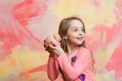 Girl hold moneybox or piggy bank for savings. Stock Images