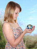 Girl hold planet Earth globe stock photos