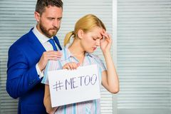 Girl hold poster hashtag me too while colleague calm down her. Victim assault at workplace. Worker share assault story. Looking for support. Discrimination stock images