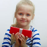 Girl hold red gift box with white ribbon. Stock Photography