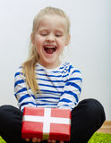 Girl hold red gift box with white ribbon. Stock Photos