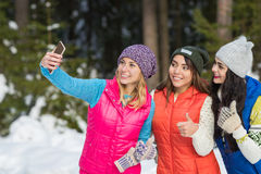 Girl Hold Smart Phone Camera Taking Selfie Photo Snow Forest Young Woman Group Outdoor Winter Royalty Free Stock Images