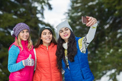 Girl Hold Smart Phone Camera Taking Selfie Photo Snow Forest Young Woman Group Outdoor Winter Stock Images