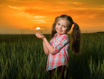 Girl hold sun in her palms Royalty Free Stock Photos
