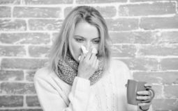 Girl hold tea mug and tissue. Runny nose and other symptoms of cold. Drinking plenty fluid important for ensuring speedy. Recovery from cold. Cold and flu royalty free stock photography