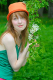 Girl hold twig Stock Images