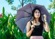 Girl hold umbrella Stock Images