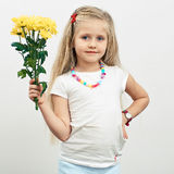 Girl hold yellow flowers. Royalty Free Stock Image