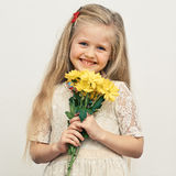 Girl hold yellow flowers. Royalty Free Stock Photo