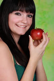 Girl holdign an apple Royalty Free Stock Photography