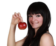 Girl holdign an apple Royalty Free Stock Photos