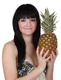 Girl holdign a pineapple Stock Photo