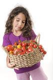 Girl holdin a basket of tomatoes royalty free stock photo