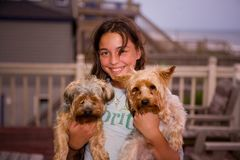 Girl Holding 2 Long Coat Small Dogs Smiling Royalty Free Stock Images