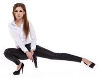 Free Girl Holding A Black Gun Stock Images - 28232104