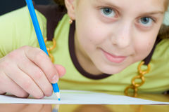 Girl Holding A Blue Pencil Royalty Free Stock Image
