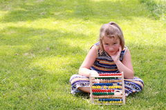 Girl holding an abacus Stock Photography