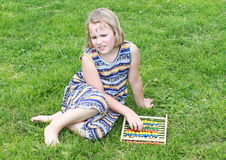 Girl holding in abacus Stock Images