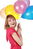 Girl holding air balloon Stock Photos
