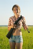 Girl holding  air rifle Royalty Free Stock Images