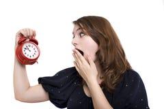 Girl holding alarm-clock Stock Photos