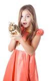 Girl holding alarm clock Royalty Free Stock Image