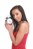 Girl holding an alarm clock and smiling Royalty Free Stock Photo