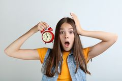 Girl holding alarm clock stock photos