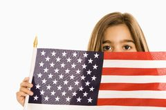 Girl holding American flag. Royalty Free Stock Photo