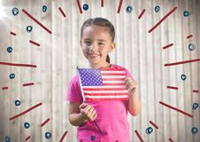 Girl holding american flag against blurry wood panel with firework doodle