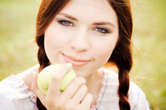 Girl Holding An Apple Royalty Free Stock Photo