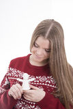 Girl holding angel. Girl holding a Christmas gift angel Royalty Free Stock Image