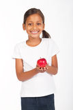 Girl holding apple. A pretty young indian girl holding a red apple Stock Image