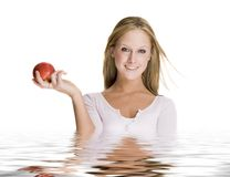 Girl holding an apple Stock Photos