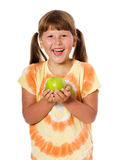 Girl holding apple Stock Photos