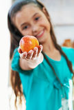 The girl is holding the apple Royalty Free Stock Photo