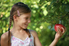 Girl holding an apple Royalty Free Stock Images