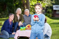 Girl Holding Apple At Campsite Royalty Free Stock Image