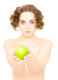 Girl holding an apple (focus on girl) Stock Images
