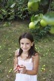 Girl Holding Apple In Garden Stock Images
