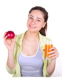 Girl holding an apple and a glass of juice Royalty Free Stock Photos