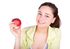 Girl holding an apple in her hand and smiling Royalty Free Stock Photo