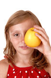 Girl holding a apple. Royalty Free Stock Image