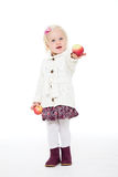 Girl holding at arm's length red apple Stock Images