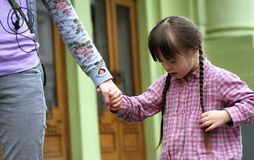 Girl holding arms of the sister Stock Photography